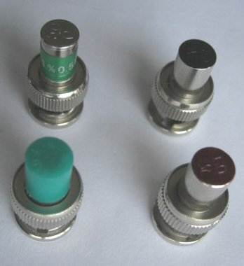 [Photograph of four locally obtained BNC loads]