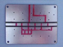 [Photograph of marked PCB]