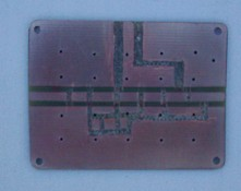 [Photograph of PCB with copper trimmed]