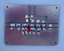 [Photograph of PCB with components mounted]