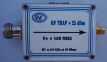 [Photograph of RF Trap Box showing connectors]